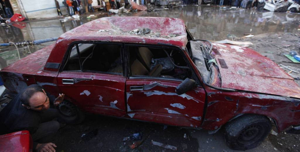 A damaged car is seen after an explosion near a security building in Egypt's Nile Delta city of Mansoura in Dakahlyia province