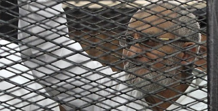 Muslim Brotherhood leader Mohammed Badie looks on from the defendant's cage during his trial with other leaders of the group in a courtroom in Cairo