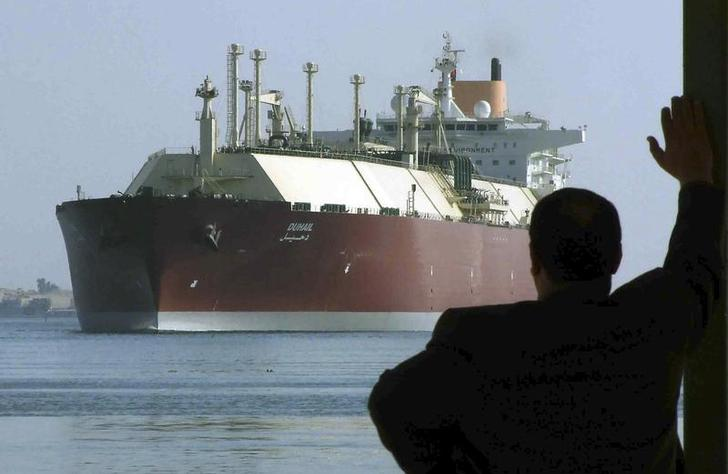 A man looks as the world's biggest Liquefied Natural Gas (LNG) tanker DUHAIL as she crosses through the Suez Canal