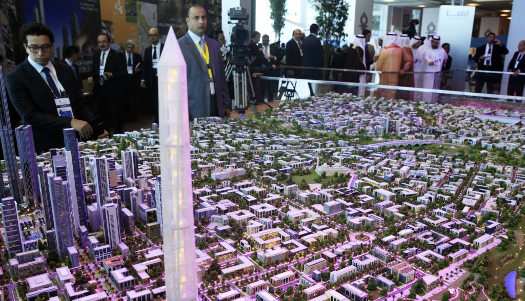A model of a planned new capital for Egypt is displayed for investors at the opening of the Egypt Economic Development Conference (EEDC) in Sharm el-Sheikh, in the South Sinai governorate, about 550 km (342 miles) south of Cairo, March 13, 2015. Egypt expects to sign several memoranda of understanding at the conference, including one for the construction of a new administrative capital with a price-tag of about $40 billion. REUTERS/Amr Abdallah Dalsh  (EGYPT)
