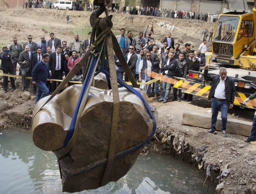 A massive statue, that may be of pharaoh Ramses II, one of the country's most famous ancient rulers, is pulled out of grondwater in a Cairo slum, Egypt, Monday, March 13, 2017. (AP Photo/Amr Nabil)