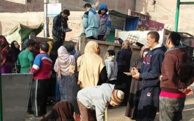 citizens_in_minyas_al-adwa_gather_around_a_garbage_truck_distributing_subsidized_bread